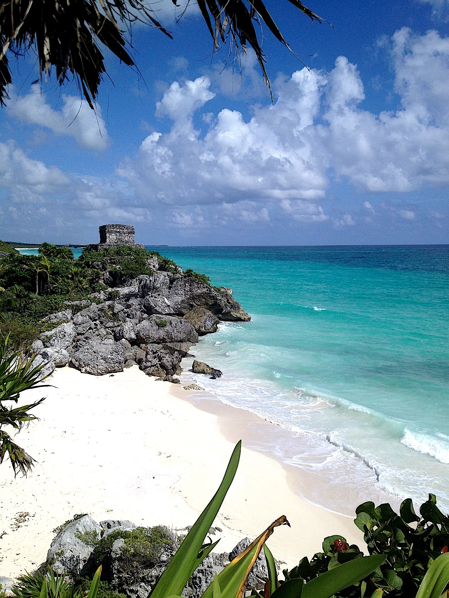 Tulum Ruins and the Caribbean Sea. Find the complete Tulum travel guide on www.ayewanderful.com.